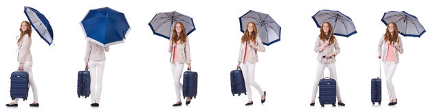 Young woman travelling with suitcase and umbrella isolated on wh Royalty Free Stock Image