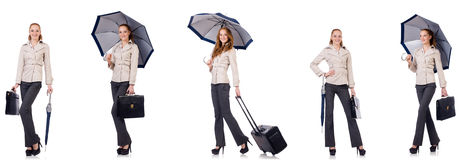 Young woman travelling with suitcase and umbrella isolated on wh Royalty Free Stock Photography