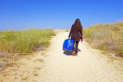 Young woman travelling to her holidays destination Stock Photo