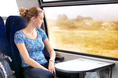 Woman looking out the window in the train Stock Photo