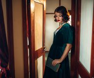 Young woman travels, vintage train compartment Royalty Free Stock Photo