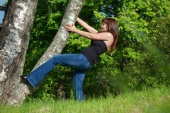 Young woman with tree. Royalty Free Stock Image
