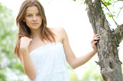 Young woman and tree Royalty Free Stock Photos