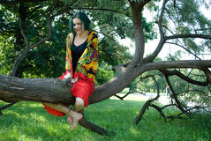 Young woman on the tree Stock Image