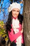 Young woman on tree enjoying autumn fall season Royalty Free Stock Image