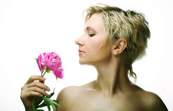 Young woman with tree-peony flower Royalty Free Stock Photography