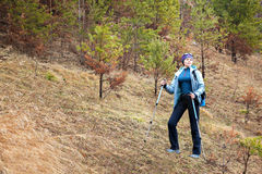 Young woman trekking in the forest. Royalty Free Stock Photo