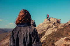 Young woman trekking in the mountains Royalty Free Stock Photos