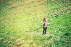 Young Woman with trekking poles hiking outdoor Royalty Free Stock Image