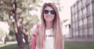 Young Woman in Trendy Outfit Smiling at the Camera Stock Photo