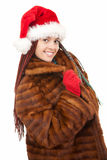 Young woman with tresses, in santa claus hat Stock Image