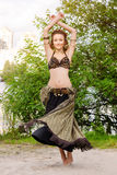 Young woman tribal american style dancer. Girl dancing and posing on the beach sand wearing belly dance costume. Ethnic Stock Images