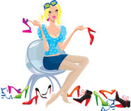 Young woman tries on shoes Royalty Free Stock Image
