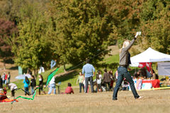 Young Woman Tries To Get Kite Airborne At Public Festival Stock Photo