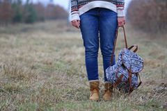 Young woman with trip bag in the nature Stock Photography