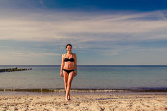 Young woman on a tropical beach Stock Photo
