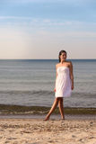 Young woman on a tropical beach Royalty Free Stock Images