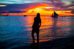 Young woman at tropical beach in beautiful sunset Royalty Free Stock Photo