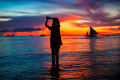 Young woman at tropical beach in beautiful sunset Royalty Free Stock Photos