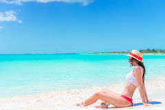 Young woman on a tropical beach with hat Stock Photos
