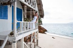 Young woman  on tropical beach house Stock Images