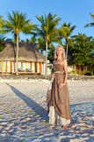 The young woman on a tropical beach. Polynesia. Royalty Free Stock Photo