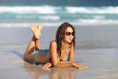 Young woman  on the tropical beach Stock Images