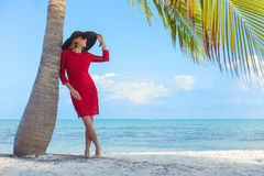 Young woman on the tropical beach in style Royalty Free Stock Photography