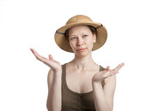 Young woman in a tropical helmet with hands palms up Stock Photography