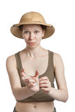 Young woman in a tropical helmet showing by fingers small size Stock Images