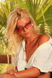 Young woman at tropical resort Stock Image
