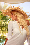 Young woman at tropical resort Stock Photography