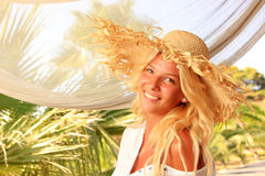 Young woman at tropical resort Royalty Free Stock Photography
