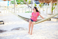 Young woman on tropical vacation relaxing in Royalty Free Stock Photos