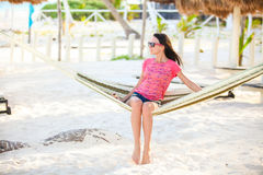 Young woman on tropical vacation relaxing in Royalty Free Stock Images