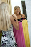 Young woman trying dress on Royalty Free Stock Photography