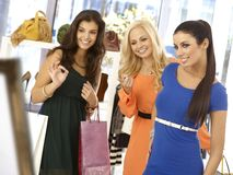 Young woman trying dress at clothes store Stock Images