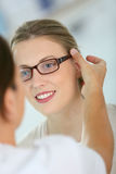Young woman trying on eyeglasses Stock Photography