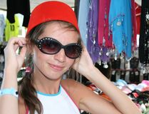 Young woman trying on fez. Young woman trying on the traditional hat worn in Turkey - fez stock image