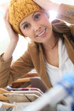 Young woman trying a hat on in astore Royalty Free Stock Image