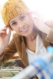Young woman trying on a hat in a store Stock Images