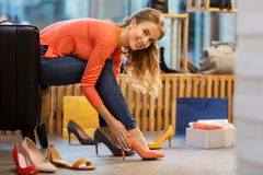 Young woman trying high heeled shoes at store Royalty Free Stock Images