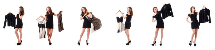 The young woman trying new clothing on white Royalty Free Stock Images