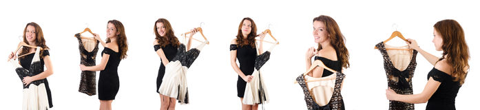 The young woman trying new clothing on white Stock Image