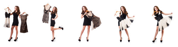 The young woman trying new clothing on white. Young woman trying new clothing on white Royalty Free Stock Photo