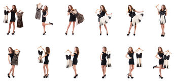 The young woman trying new clothing on white. Young woman trying new clothing on white Stock Photography