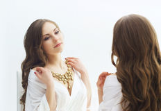 Young woman trying new jewelry in a studio Stock Photography