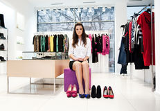 Young woman trying on  shoes Royalty Free Stock Images