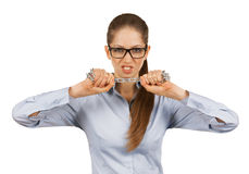 Young woman trying to break a steel chain. Aggressive young woman trying to break a steel chain Royalty Free Stock Image