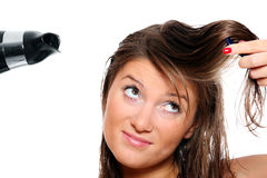 Young woman trying to brush her hair Stock Image